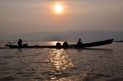 Inle Lake. Myanmar. Fishing boat returns at sunset Royalty Free Stock Photos