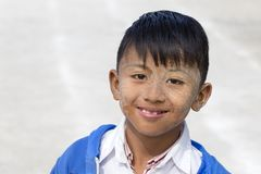 Portrait young boy with thanaka on face in local school in Inle Lake, Myanmar, Burma Stock Photo