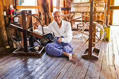 INLE LAKE, MYANMAR - November 22, 2015: Hand weaving in a factor Stock Photography