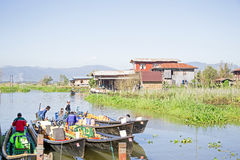 INLE LAKE, MYANMAR - NOVEMBER 23, 2015: Local sellers with their Royalty Free Stock Images