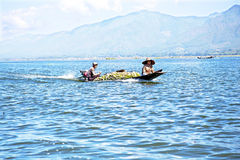 INLE LAKE, MYANMAR - NOVEMBER 23, 2015: Local sellers with their Stock Photography