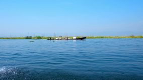 Tourist trip on Inle lake, Myanmar. Inle lake is one of the most popular tourist resorts of Myanmar, locals offer interesting boat trips with visiting of stock video footage