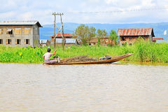 Inle Lake Resident Paddling On The Lake, Myanmar. Inle Lake Resident Paddling On The Lake In Myanmar Stock Images
