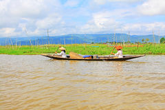 Inle Lake Resident Paddling On The Lake, Myanmar. Inle Lake Resident Paddling On The Lake In Myanmar Stock Image