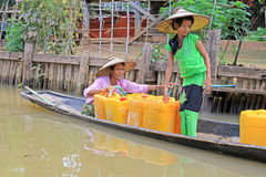 Inle Lake Resident Take The Freshwater With Barrel, Myanmar. Inle Lake Inle Lake Resident Take The Freshwater With Barrel In Myanmar Royalty Free Stock Photography