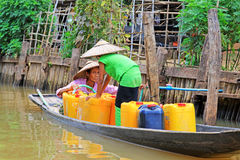 Inle Lake Resident Take The Freshwater With Barrel, Myanmar. Inle Lake Inle Lake Resident Take The Freshwater With Barrel In Myanmar Royalty Free Stock Photo