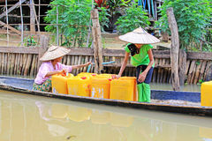 Inle Lake Resident Take The Freshwater With Barrel, Myanmar. Inle Lake Inle Lake Resident Take The Freshwater With Barrel In Myanmar Stock Images