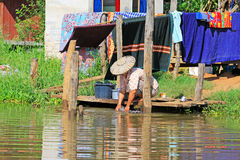 Inle Lake Resident Washing Clothes At The Lakeside, Myanmar. Inle Lake Resident Washing Clothes At The In Myanmar Stock Photos