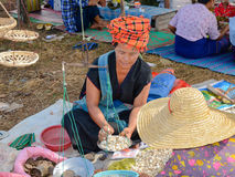 INLE LAKE, SHAN STATE, MYANMAR- SEPTEMBER 23, 2016: Burmese woman selling fresh and dry products at the Friday market Stock Image