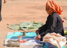 INLE LAKE, SHAN STATE, MYANMAR- SEPTEMBER 23, 2016: Burmese woman selling fresh and dry products at the Friday market Royalty Free Stock Images