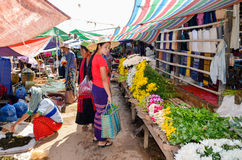 INLE LAKE, SHAN STATE, MYANMAR- SEPTEMBER 23, 2016: Locals selling and buying fresh and dry products at the Friday market Royalty Free Stock Photography