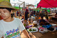 INLE LAKE, SHAN STATE, MYANMAR- SEPTEMBER 23, 2016: Locals selling and buying fresh and dry products at the Friday market. This market is a melting pot of seven Stock Images