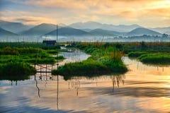 Inle lake at sunrise. The beautiful Inle lake in Myanmar at sunrise stock photos