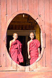 INLE,MYANMAR-NOVEMBER 24 : Young novice monks at window Royalty Free Stock Images