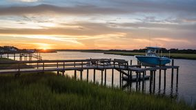 Inlet Sunset on a Dock royalty free stock photography