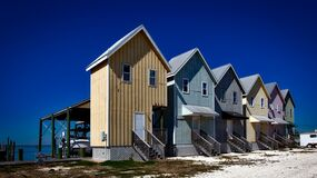 Inline House Near Seashore during Daytime Royalty Free Stock Photography