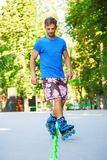 Inline roller skater on a slalom course Stock Images