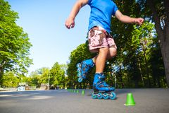 Inline roller skater on a slalom course Royalty Free Stock Photo