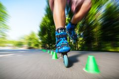 Inline roller skater on a slalom course Royalty Free Stock Images