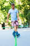Inline roller skater on a slalom course Royalty Free Stock Photography