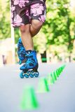 Inline roller skater on a slalom course Stock Photo