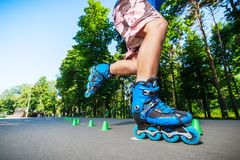 Inline roller skater on a slalom course Royalty Free Stock Image