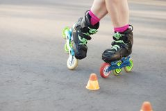 Inline roller skating, rollerblading, slalom. roller legs royalty free stock photos