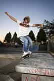 Inline Skater Doing A Grind On Bench Royalty Free Stock Photo