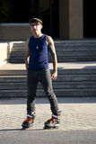 Inline skater standing in front of stairs Royalty Free Stock Photography