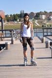 Inline-skating at the balk. Woman is skating on a balk Royalty Free Stock Photos