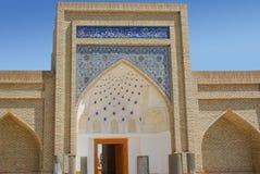 Inloggning med kupolen och stjärnor i Bukhara Arkivbild