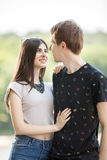 Inlove couple taking a walk in the park. Lifestyle and relationship. Young inlove boyfriend and girlfriend Stock Photo