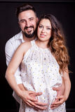 Inlove pregnant woman with her husband in studio photo Stock Images
