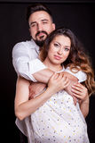 Inlove pregnant woman with her husband in studio photo Stock Photography