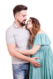 Inlove pregnant woman with her partner in studio photo Stock Photography