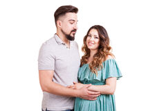 Inlove pregnant woman with her partner in studio photo Royalty Free Stock Images