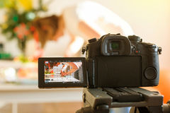 Inluencer vlogger working on table video camera Royalty Free Stock Image