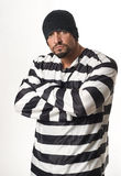 Inmate Bad Boy. Man dressed in convict costume with rings and beanie Stock Photo