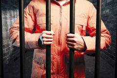 Inmate Inside Dark Prison Cell At Night Stock Photography