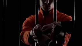 Inmate put on jail handcuffs waiting for trial, crime punishment, law breaking. Stock photo stock photo