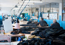 Inmates at prison sewing workshop Royalty Free Stock Photo