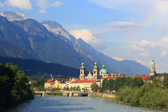 Inn-Bridge and Innsbruck skyline. With a rainbow Stock Photos