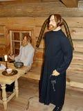 At the Inn. Innkeeper and peasants in the Inn. Museum-reserve of wooden architecture and folk art Nizhnyaya Sinyachikha, Sverdlovsk oblast, Russia stock images