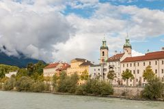 Inn river in Innsbruck with Innsbruck Cathedral. Austria royalty free stock image