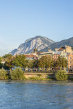 Inn river on its way through Innsbruck, Austria. INNSBRUCK, AUSTRIA - AUG 16: Inn river, a 517 kilometres long tributary of the Danube on its way through the Stock Image