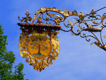 Inn sign. Ancient, gold plated ironclad inn sign royalty free stock image