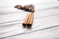 Сinnamon. Cinnamon on the coffee beans background Stock Photo