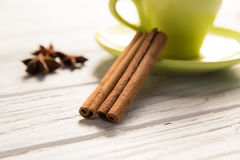 Сinnamon. Cinnamon on the coffee beans background Royalty Free Stock Images