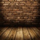 Innenraum mit Backsteinmauerhintergrund Lizenzfreie Stockfotos