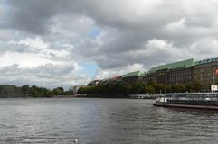 Inner Alster lake. Is located in the east of The City Hall Square, like a pearl inlaid in the center of the city, with a picturesque landscape. The beautiful Royalty Free Stock Images